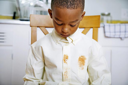 boy with stain on shirt